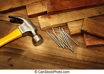 Hammer, nails and pieces of wood
