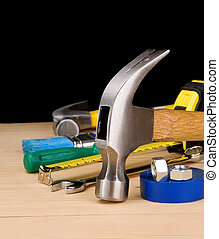 hammer and other construction tools on wooden brick isolated...