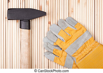 Hammer and Protective Gloves.