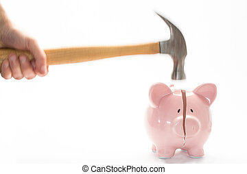 Hammer breaking piggy bank on white background