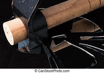 hammer broken mirror pieces on a black background