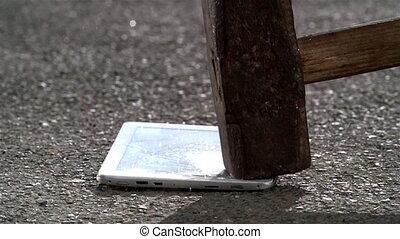 Hammer crash hitting a tablet pc computer, broken touch screen