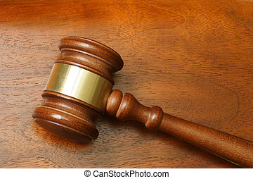 Hammer - Judge hammer over a wooden background