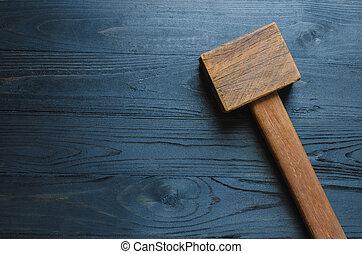 hammer on black wooden background