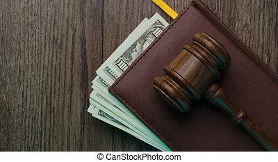 Hammer on folder with money