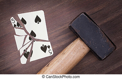 Hammer with a broken card, five of spades - Hammer with a...