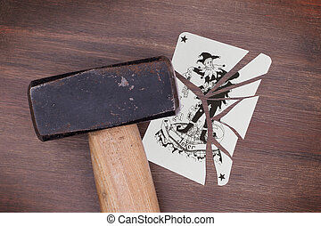 Hammer with a broken card, joker