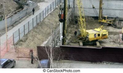hammering concrete pile at construction site. Timelapse