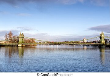 Hammersmith Bridge and south riverside of Thames London