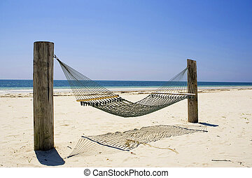 A hammock sits quietly in the tropical breeze in Bishop's Point, Grand Bahama Island.