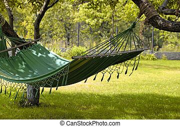 Hammock in the summer garden - Beautiful landscape with...
