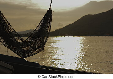 Hammock of fishing and the natural scenery of Lake Songkhla.