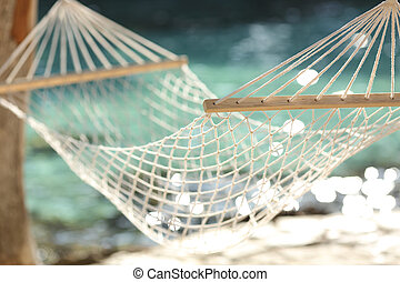 Hammock on a tropical beach resort vacation concept - Close...