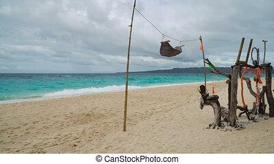 Hammock on a tropical beach.