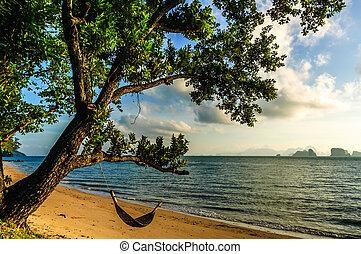 Hammock on beach, southern Thailand
