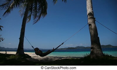 Hammock on beautiful beach.