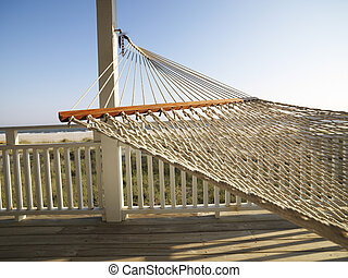 Porch with hammock at beach at Bald Head Island, North Carolina.