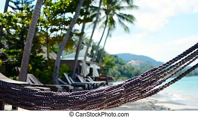 Hammock on the beach near the sea.