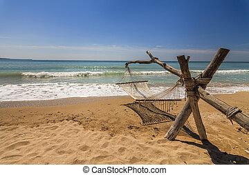 Hammock on the shore of the sea.