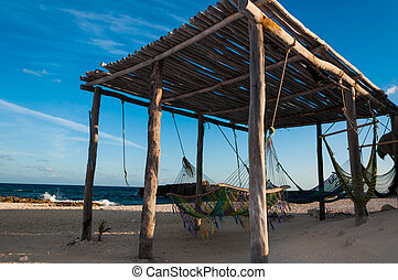 Hammocks on the idyllic beach on Cozumel island Yucatan...