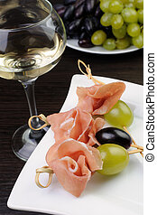 Hamon with grapes on a skewer - Appetizer of ham and grapes...