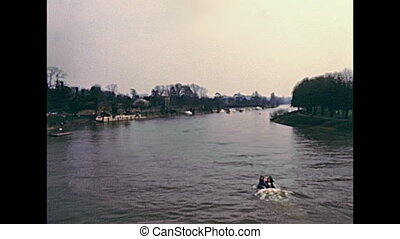 Hampton Court Palace by the River Thames on 70s. Historic...