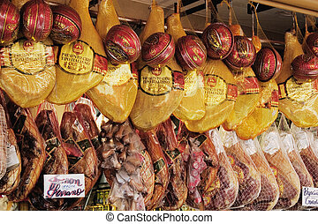Hams and cheeses in a street market