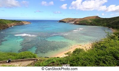 Aerial view of famous Hanauma Bay nature reserve with beach and coral reef in Oahu island, Hawaii, United States. Summer time leisure and water sports recreation. Nature scenic landscape.