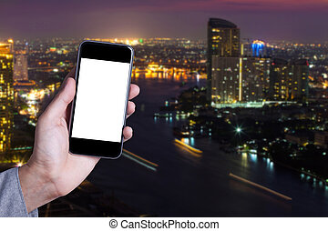 Hand a part of man holding smartphone empty screen with cityscape background.