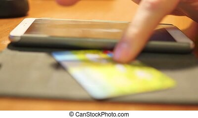 hand a wire transfer of money with credit card using a smartphone