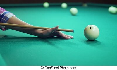 Hand aiming and hits the ball of russian billiards. - Female...
