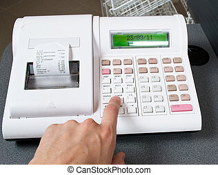hand and cash register
