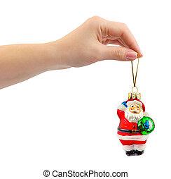 Hand and christmas toy Santa
