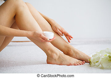 Hand and Nail Care. Beautiful Women's Feet with Perfect Pedicure. Beauty Day The Girl Holding Orchid Flowers. Spa Manicure