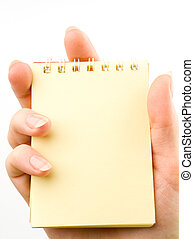 Hand and notepad isolated on white