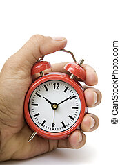 Hand and Red Alarm Clock