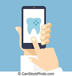 Hand and smartphone with dental app