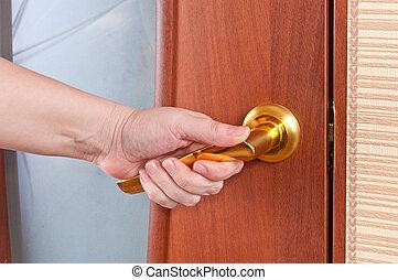 Hand and the door handle
