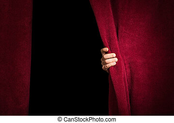 Hand appearing beneath the curtain. Red curtain.