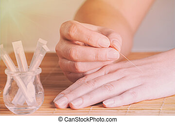 Hand applying acupuncture needle