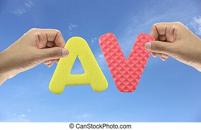 Hand arrange alphabet AV of acronym Adult Video. - Hand ...