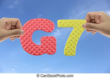 Hand arrange alphabet G7 of acronym major advanced economies in trade integration.