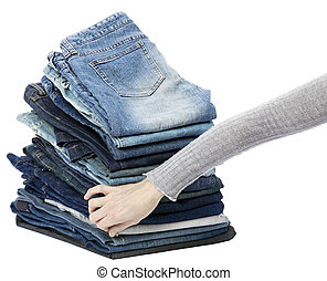 Hand Arranging Jeans Stack
