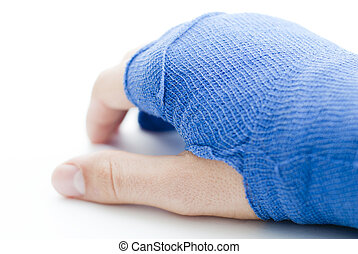 bandaged broken male hand on white background and shallow depth of field and copy space