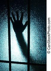 Hand behind glass