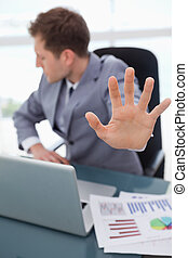 Hand being used to signal rejection - Hand of businessman...