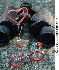 Hand Binoculars and Bicycle Figure with Love Concept