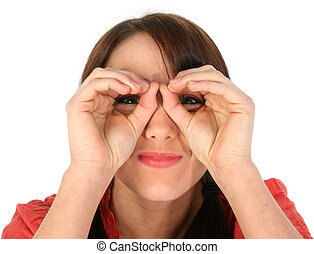 Hand Binoculars - Pretty young woman making Hand Binoculars....