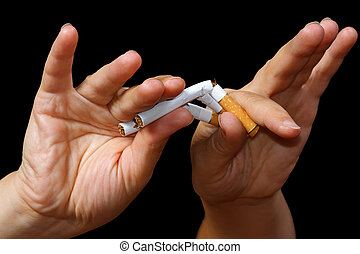 Hand breaking a cigarette. Stop smoking