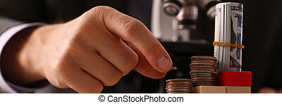 Hand businessman in suit hold quarter in background looking ...